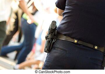 Policeman watching over pedestrian crossing street