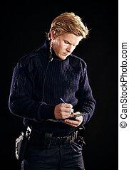 Policeman in uniform writing a ticket - Policeman in uniform...