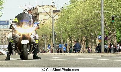 Policeman on a motorcycle - Policeman on a motorcycle, wide...