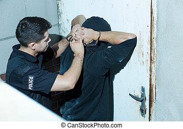 Policeman overpowering kidnapper