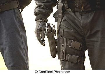 Policeman with handgun on his holster