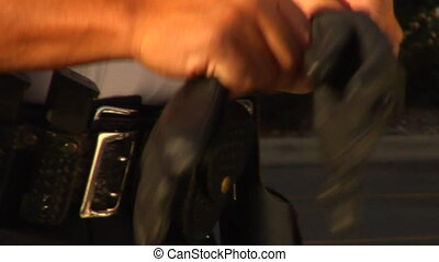 Policeman putting on black leather gloves