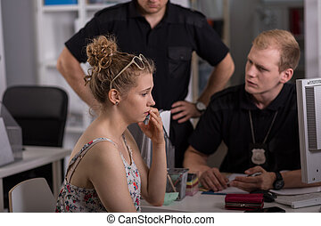 Policeman questioning woman - Young policeman questioning...