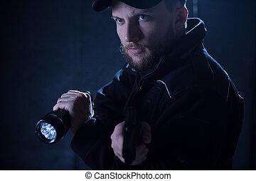 Policeman using flashlight