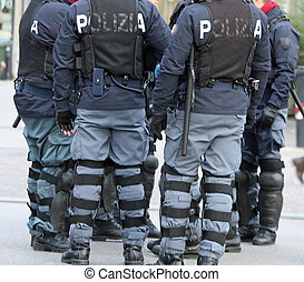 policemen with bullet-proof jacket and the baton - cops with...