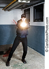 Policewoman aiming a flashlight in pursuit of a suspect