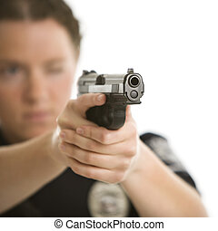 Policewoman aiming gun. - Close up of mid adult female...
