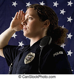 Policewoman saluting. - Portrait of mid adult Caucasian ...