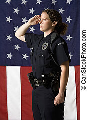 Policewoman saluting. - Portrait of mid adult Caucasian...