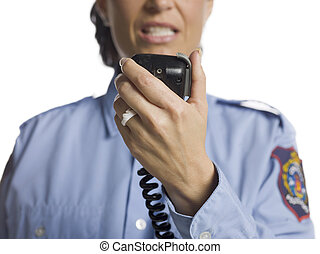 policewoman with cb radio - Cropped image of an angry...