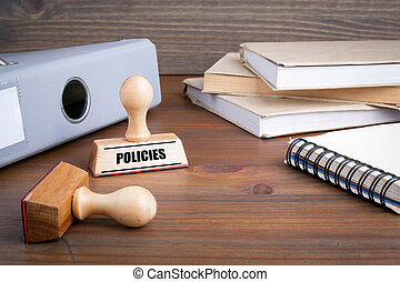 Policies. Rubber Stamp on desk in the Office