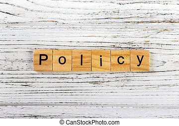 Policy word made with wooden blocks concept