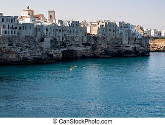 View of Polignano a mare - picturesque little town on cliffs of the Adriatic Sea. Apulia, Southern Italy