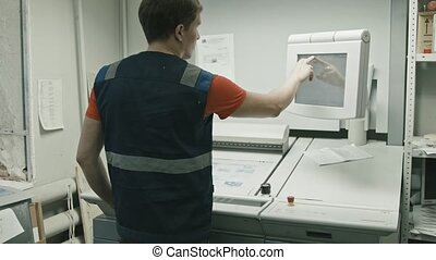 Poligraphy industry - worker use touch screen monitor for...