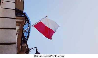 Polish flag on a building in Warsaw, Poland, national independence day. High quality 4k footage