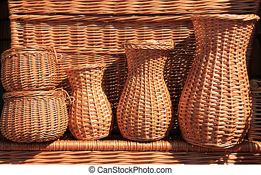 Handicraft in Poland. Outdoor market stall with wicker baskets.