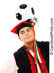 Polish man in a traditional outfit with football on head