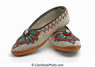 polish mountaineers wear such traditional slippers -...