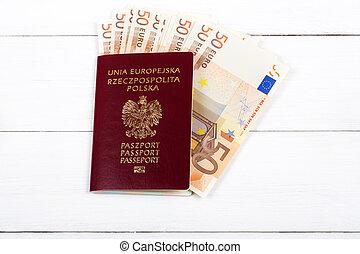 Polish passport with European money