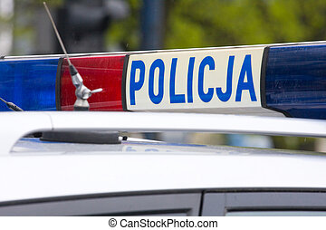 Polish police sign on a roof of police car