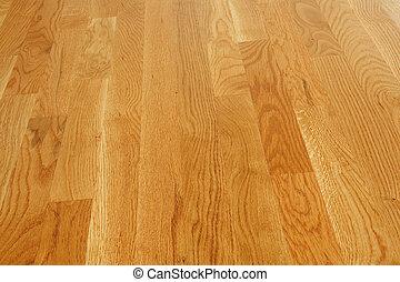 Polished Hardwood Floor - A clean and polished hardwood...