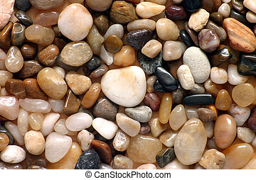 Polished pebbles close up