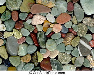 Polished pebbles and semi-precious stones background