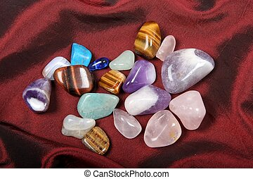 Polished Semi Precious Stones on a red cloth background