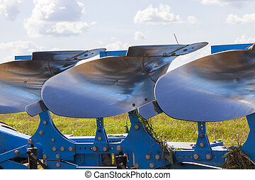 polished steel plows