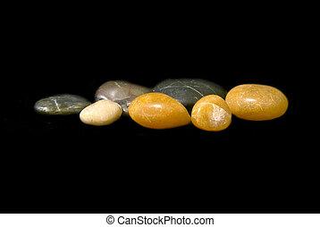 polished stones floaring on black