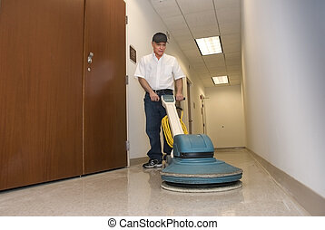 cleaner polishing office hallway