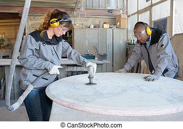 polishing the marble