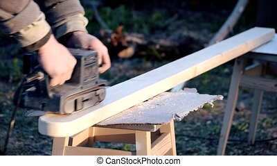 Polishing wooden beam with belt sander - Sanding and...