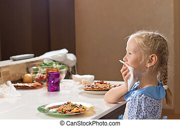 Polite little girl eating homemade pizza