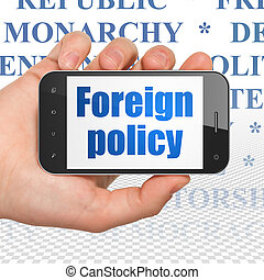 Political concept: Hand Holding Smartphone with Foreign Policy on display