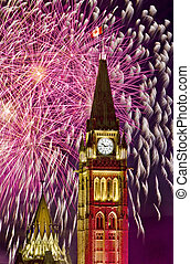 The canadian Parliament Centre Block surrounded by fireworks during the Canada day fireworks display.