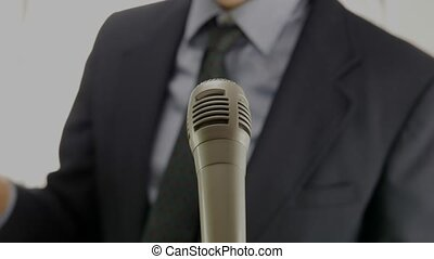 politician speech - out of focus man speaking in front of...