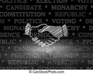 Politics concept: Handshake in grunge dark room