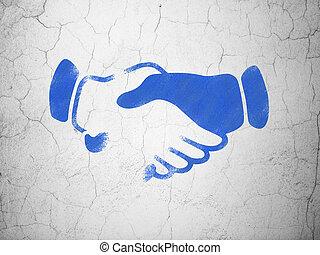 Politics concept: Handshake on wall background
