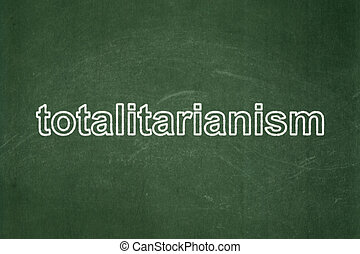 Politics concept: Totalitarianism on chalkboard background