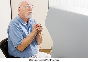 Politics & Religion - Senior man at the polls praying for...