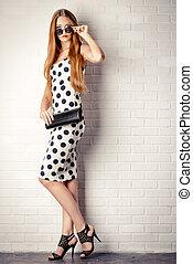 polka-dot - Fashionable lady near white brick wall. Beauty, ...