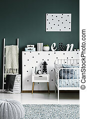 Polka dot poster on a dark green walk in a scandinavian style white bedroom interior for a teenager