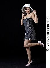 polka dotted dress - woman having fun wearing polka dotted...