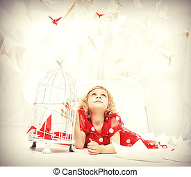 polka dress - Portrait of a beautiful little girl lying on a...