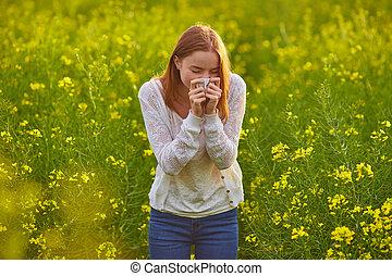 Pollen allergy, girl sneezing