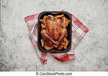 pollo arrostito, o, tacchino, con, patate, in, nero, acciaio, muffa