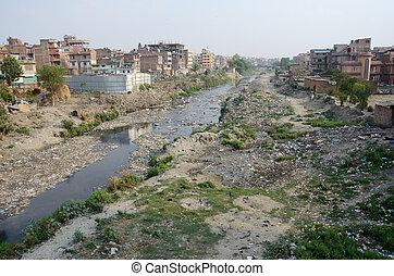 Polluted slum area near sacred Bagmati river in Kathmandu,...