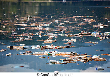 polluted water - water polluted by many plastic bottles,...