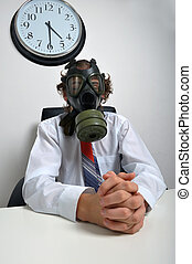 Businessman standing at desk with gas mask on face